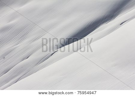 Snowy mountain slope, winter background