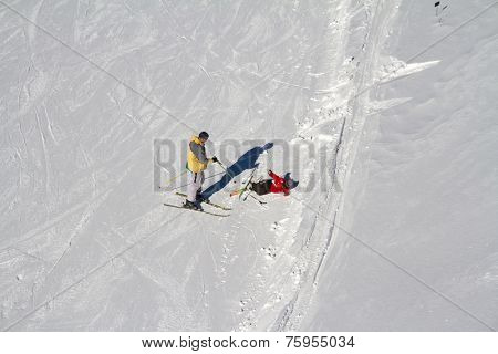 Accident on the mountain ski slope, fallen skier
