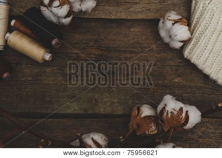 Threads with cotton flower on the table
