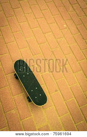 Lone Skateboard On Concrete Background With Copy Space