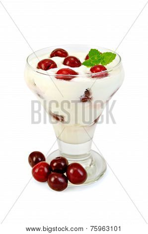 Yogurt thick with cherry in glass goblet
