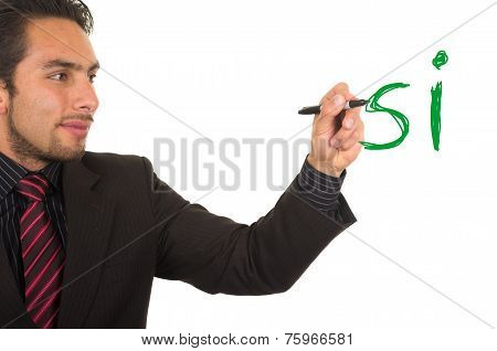 young handsome businessman writing on whiteboard with marker