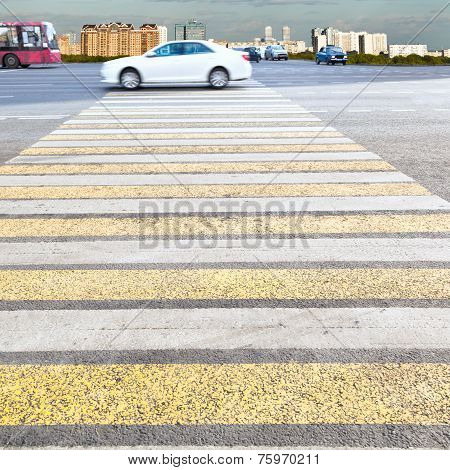 Yellow And White Crossing Zebra On Urban Street