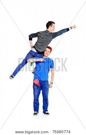 Two modern male dancers at studio. Superman concept. Isolated over white.