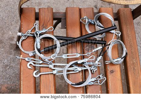 Hooks, Fastening, Rope Lying On A Wooden Bench