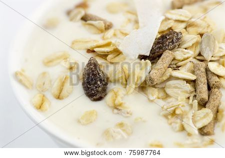 Macro Closeup Of Delicious Low-fat Yogurt With Oats, Muesli, Bran, Almonds And Dehydrated Fruit