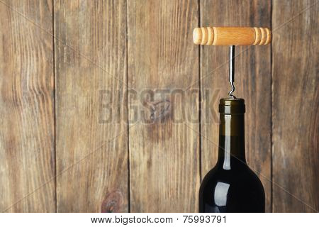 Bottle opener close-up, on wooden background