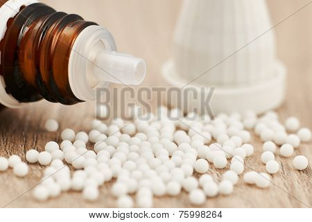 Homeopathic Granules Scattered On A Table