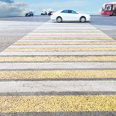 stock photo of zebra crossing  - yellow and white crossing zebra of pedestrian crosswalk on road - JPG