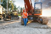 foto of heavy equipment operator  - Portrait of man working in a helmet about Excavator - JPG