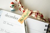 stock photo of last day work  - pen point to holidays note on december - JPG