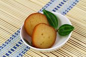 picture of gulab  - Gulab jamun dessert in bowl on bamboo mat - JPG