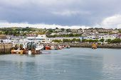 stock photo of dock  - Fishing boat docked in the harbor at Howth - JPG