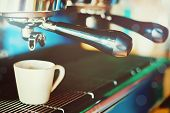 stock photo of machine  - Professional coffee machine making espresso in a cafe - JPG