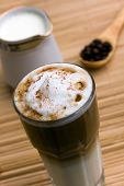 Latte Macchiato , a delicious italian  drink with milk and espresso