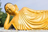 stock photo of recliner  - Reclining golden Buddha statue at Srisoonthorm temple Phuket - JPG
