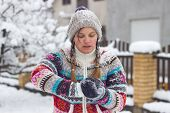 pic of snowball-fight  - Portrait of a happy young woman in the middle of a making a snowball
