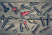 foto of drill bit  - different types of drill bits on old wood background - JPG