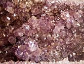 stock photo of precious stone  - amethyst precious stone druse crystals closeup pattern - JPG
