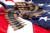 image of cartridge  - Cartridge belt for machine gun on an american flag - JPG