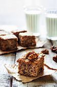 pic of walnut  - oatmeal cake with dates and walnuts on a dark wood background - JPG