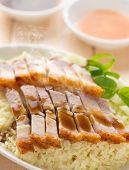 stock photo of pork belly  - Chinese roasted pork belly rice served with soy and seafood sauce - JPG