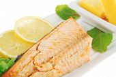 stock photo of butter-lettuce  - roast salmon fillet with butter on white plate - JPG