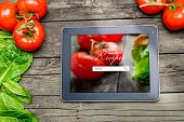 pic of recipe card  - Online Cooking recipes on tablet pc with vegetables on backround.
