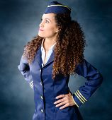 foto of flight attendant  - Attractive Flight attendant being determined and strong - JPG