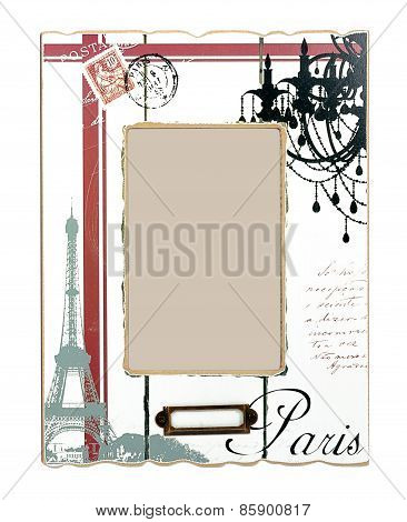 White aged photo frame with drawings of Eiffel Tower and black word Paris. Isolated place for your p