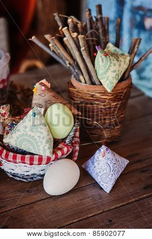 handmade fabric chicken and eggs for easter on wooden table in country house