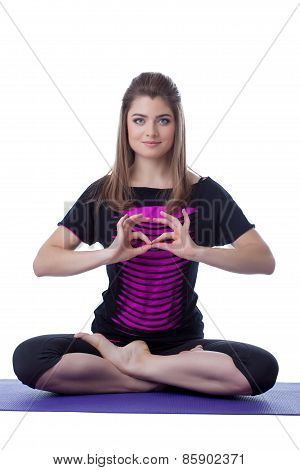 Charming woman posing in lotus position