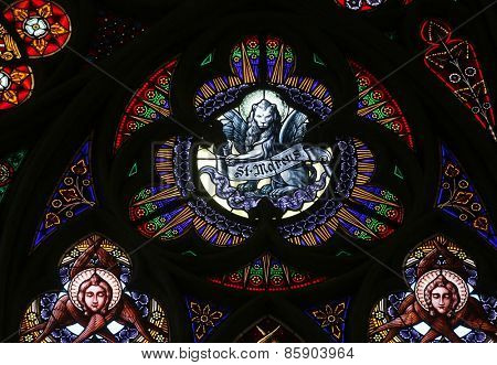 VIENNA, AUSTRIA - OCTOBER 11: Saint Mark the Evangelist, Stained glass in Votiv Kirche (The Votive Church). It is a neo-Gothic church located on the Ringstrabe in Vienna, Austria on October 11, 2014
