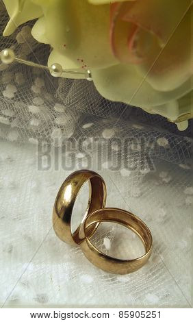 Gold Wedding Rings With A Bridal Bouquet.