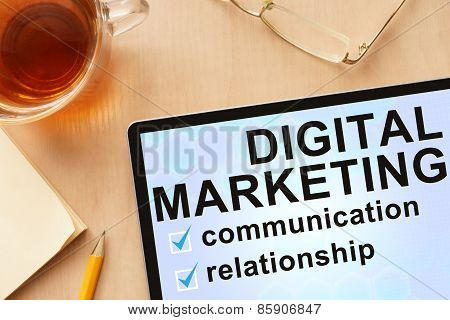 Tablet with words   digital marketing.