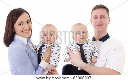 Happy Parents With Little Twins Isolated On White