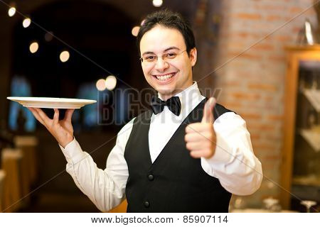 Waiter holding a plate