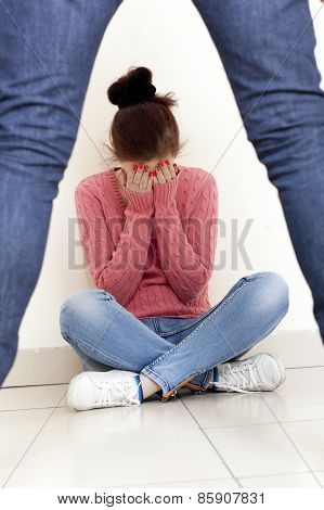 Concept photo of domestic violence. Woman in fear of domestic abuse