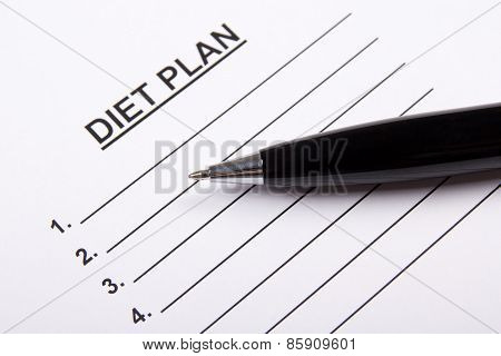 Sheet Of Paper With Diet Plan And Pen