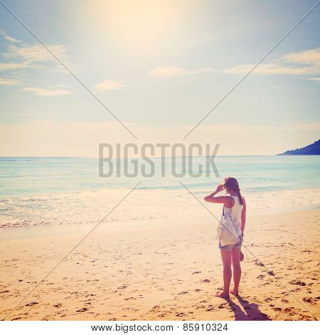 summer travel. young woman is standing on beach