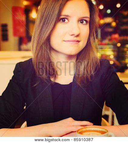 young woman in modern cafe