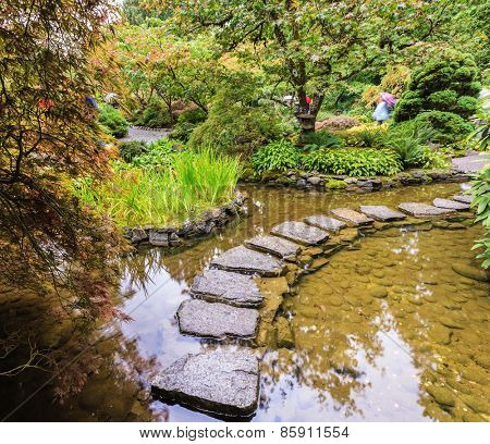 The track of the stones in the Japanese part of the garden. Amazingly beautiful decorative private garden in western Canada Butchart Gardens