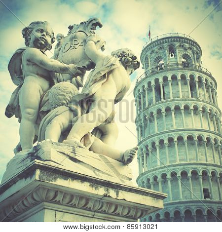La Fontana dei Putti Statue and Leaning Tower of Pisa, Italy. Instagram style filtred image