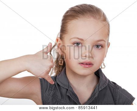 Little Girl making a call me gesture, against white background