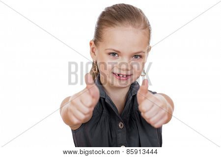 Little girl is showing thumb up gesture using both hands, isolated over white