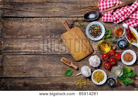 Ingredients for cooking and empty cutting board on an old wooden table