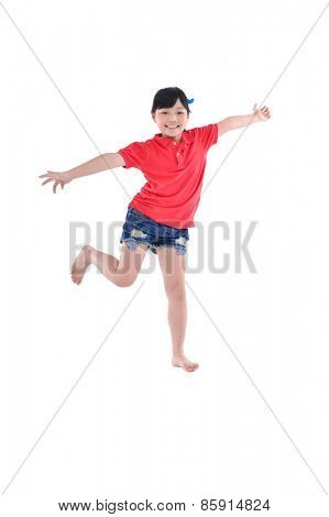 happy little girl jumping in air