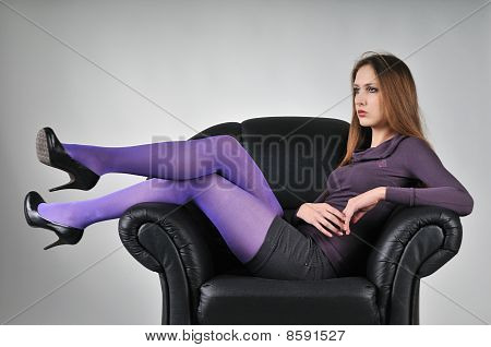 Portrait Of Young Woman Sitting In Big Armchair
