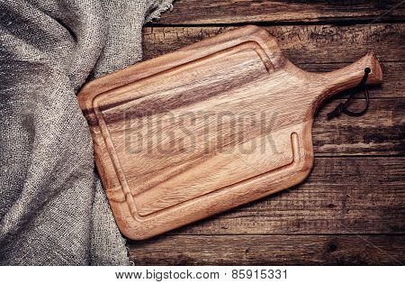 Empty vintage cutting board on old wooden background