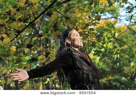 Woman Enjoys Sun In Fall Time Outdoors